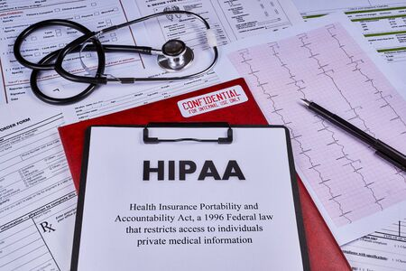 Health Insurance Portability and accountability act HIPAA, red folder with inscription confidential and stethoscope on the medical documents background Reklamní fotografie