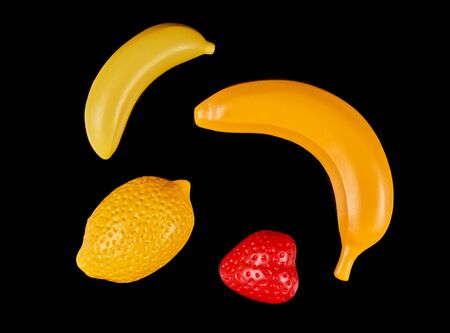Plastic fruits isolated on a dark background