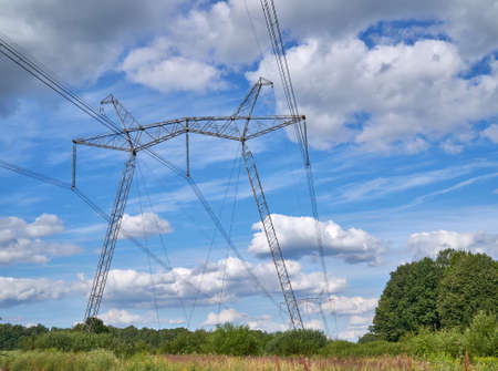 The 750 kV line support is a power distribution and transmission unit to the consumer. A large electric support stands on the sky background Foto de archivo
