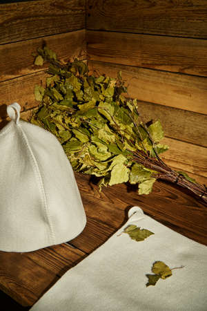 Bath supplies. The birch broom lies in the steam room on the bench next to the bath cap and napkin.