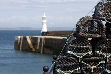 lobster pots: Lighthouse and lobster pots