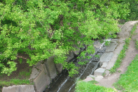 somewhere: A babbling brook somewhere in the park of Kolomenskoye, Moscow, Russia Stock Photo
