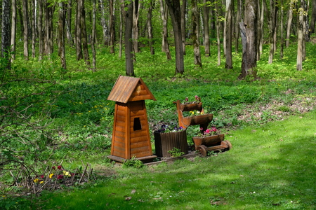 Birdhouse and some flowers - Tsaritsyno park, Moscow, Russia Stock Photo