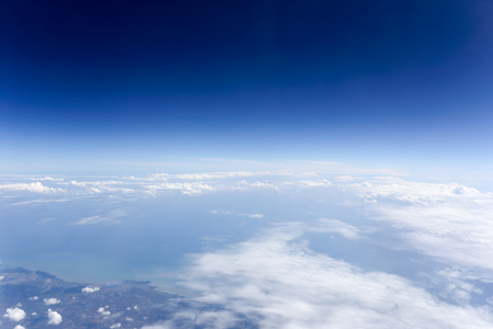 skyscape: White clouds and blue sky seen from airplane. Stock Photo