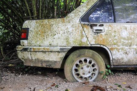 junk yard: Old rusted car in junk yard