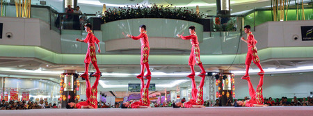 Pathumthani, Thailand - FEBRUARY 18, 2015 : The Chinese Acrobats Of Xinjiand perform at Future Park Rangsit. Editorial