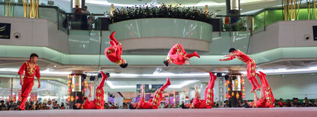 perform: Pathumthani, Thailand - FEBRUARY 18, 2015 : The Chinese Acrobats Of Xinjiand perform at Future Park Rangsit. Editorial