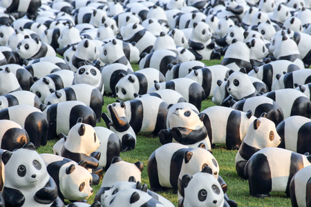 Bangkok, Thailand - March 12, 2016 : 1600 Pandas World Tour in Thailand by WWF at Santichai Prakan Park. 1600 paper marche pandas are made from recycled materials to represent 1600 pandas left in the wild.