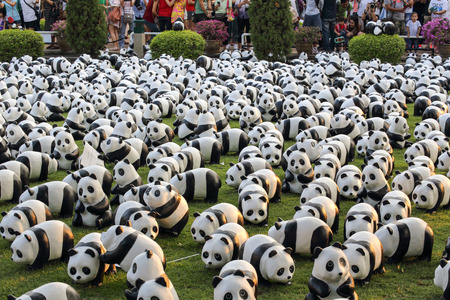 represent: Bangkok, Thailand - March 12, 2016 : 1600 Pandas World Tour in Thailand by WWF at Santichai Prakan Park. 1600 paper marche pandas are made from recycled materials to represent 1600 pandas left in the wild.