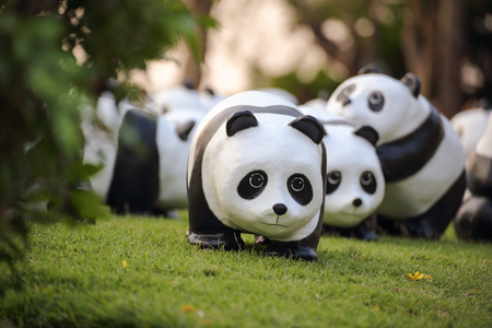 wwf: Bangkok, Thailand - March 12, 2016 : 1600 Pandas World Tour in Thailand by WWF at Santichai Prakan Park. 1600 paper marche pandas are made from recycled materials to represent 1600 pandas left in the wild.