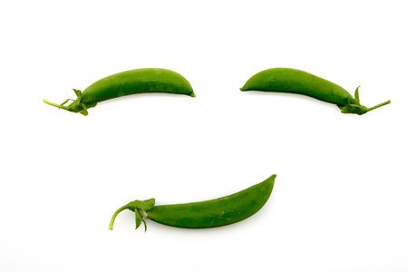 Smile green peas  isolated on white background Stock Photo
