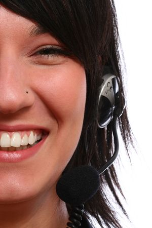 Closeup of a beautiful, young brunette woman with headset photo