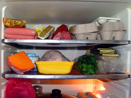 A view of a refrigerator filled with food Imagens