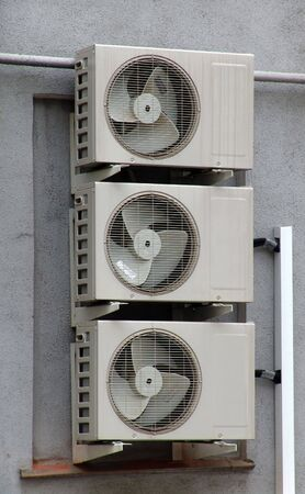 A set of generic conditionners on a wall Imagens