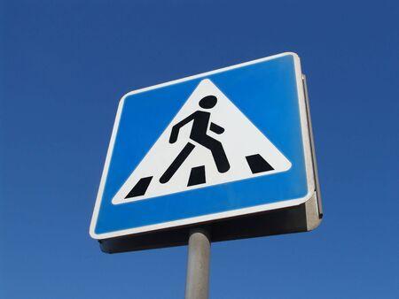 A blue road sign
