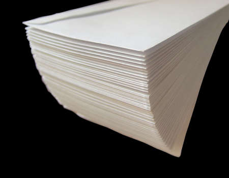 A stack of envelopes isolated on black Imagens