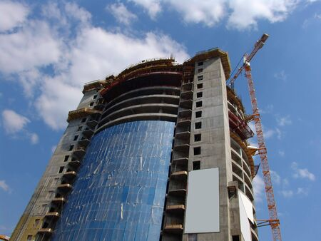 A skyscraper under construction with blank ad places Stock Photo