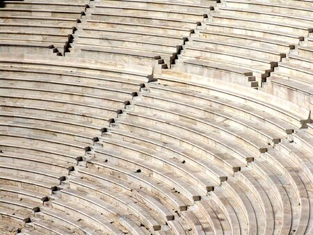 Ruins of an ancient greek Amphitheater in Athens, rows of seats and steps