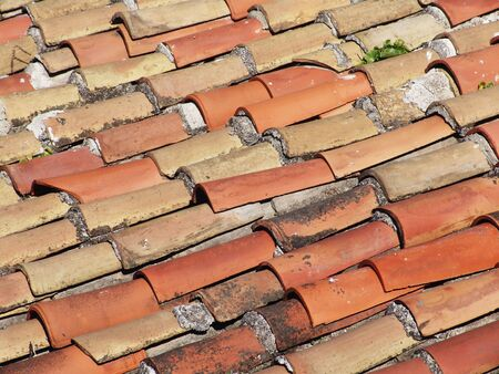 A closeup of red tiles on a roof