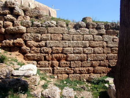 A background view of a stone wall as a part of an ancient ruin photo