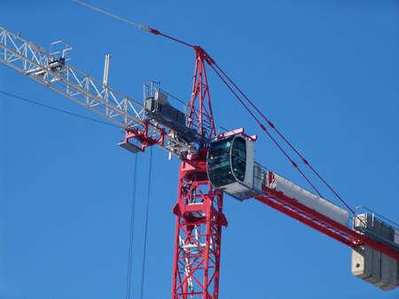 A construction crane over a blue sky Stock Photo
