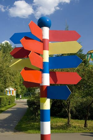 A pylone with empty direction marks in a theme park