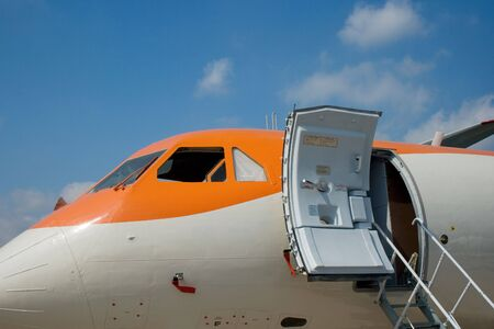 A plane side with an open door