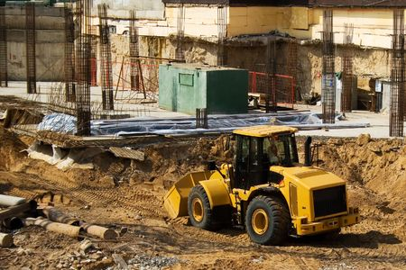 A yellow buldozzer on a construction site