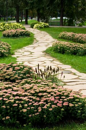 A decorated stone path in a city park Imagens