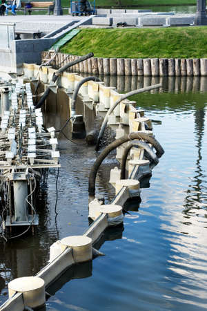 A system of pump engines and tubes emptying a fountain