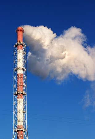 pharm: A smoking factory chimney over a blue sky