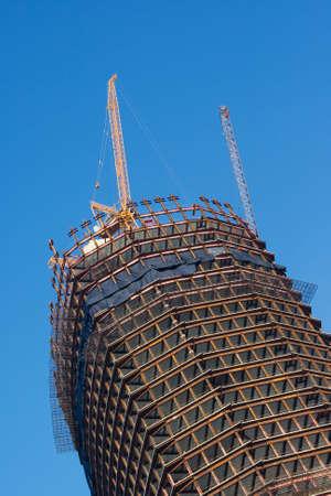buildup: A skyscraper construction site over a blue sky