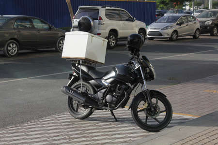 A typical food delivery bike in a warm tropical environment