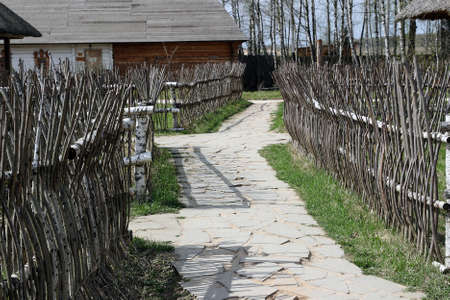 Traditional ukrainian fence made of wooden sticks Stock Photo