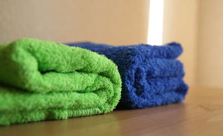 Two colorful towels on a wooden table
