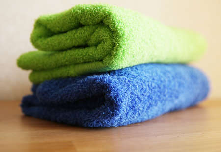 Close view of two towels on a wooden table Stock Photo