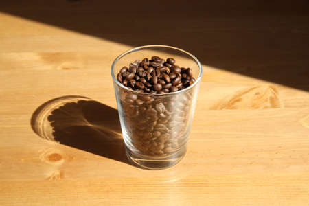 View of a glass full of coffee beans Stock Photo - 81389083