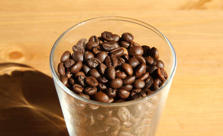 Close view of a glass fulled with coffee beans Stock Photo - 81389084
