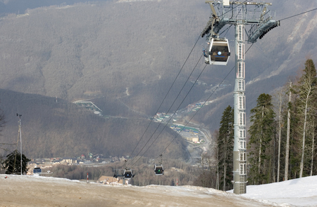 Cabins on a mountain lift moving people up and down on Olympic games 2014 in Sochi