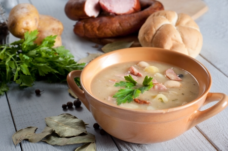 Thick bean soup with traditional sausage photo