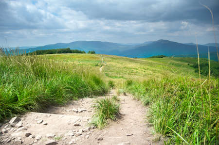 Landscape of a hiking trail in the mountains photo