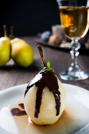 Delicious pear dessert with chocolate and amaretto liqueur photo