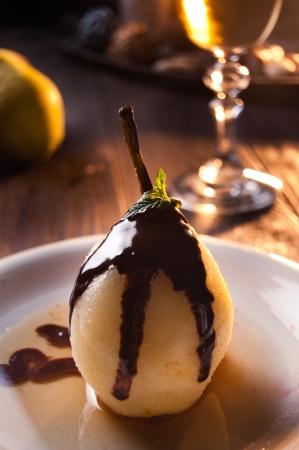 Delicious pear dessert with chocolate and amaretto liqueur photo