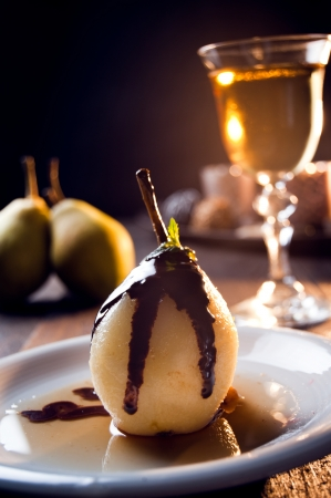 Photo of delicious pear dessert with chocolate and amaretto liqueur photo