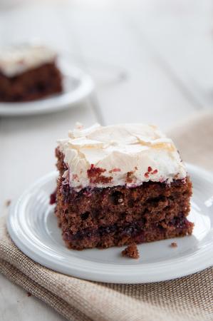meringue: Piece of cherry and meringue cake Stock Photo