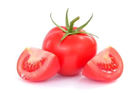 Fresh tomatoes with green leaves isolated on white background  photo