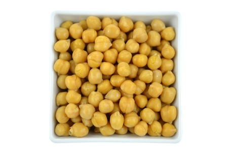 garbanzo bean: Chickpeas in a small white bowl. High resolution color image. Stock Photo