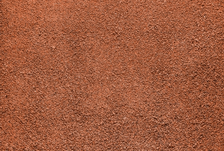 Red dry grungy clay tennis background texture   photo