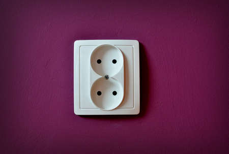 Alone outlet on wall background. High resolution color image. Stock Photo - 21675879