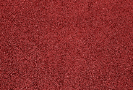 Red dry grungy clay tennis background texture